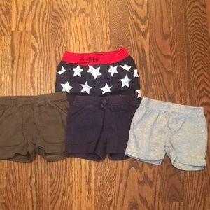 3 pairs of Carters shorts and 1 bathinsuit